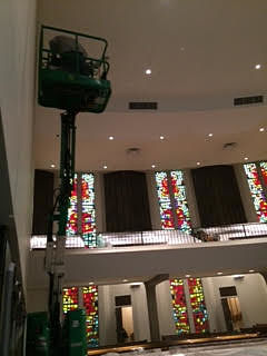 Incarnation parish interior with cherry picker machine working