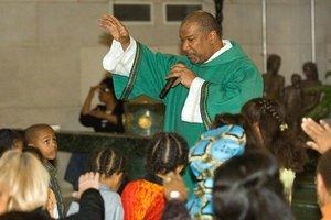 Deacon Royce Winters speaking to church